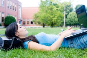 online high school student lawn laptop