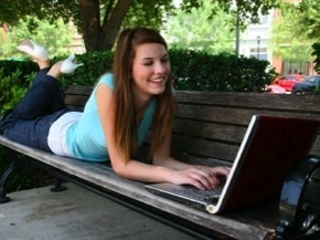 online high school student girl bench laptop